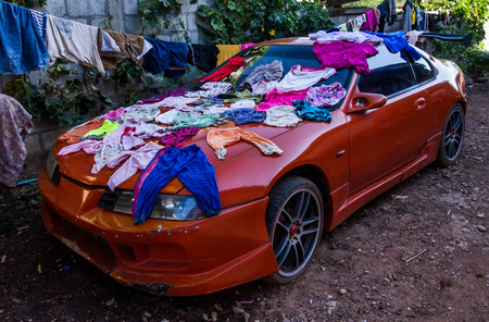 sportcar: Dry clothes on the sportcar . Stock Photo