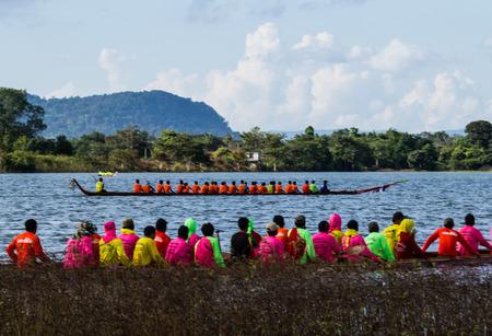 in unison: SAVANNAKHET,LAOS-NOVEMBER 13 : Long boat racing in Setamuak river at Savannakhet,Laos on November 13 ,2015.Long boat racing is the popular culture in Laos .