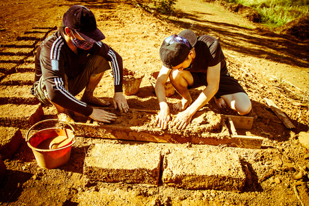 earthen: How to make earthen  brick. Stock Photo