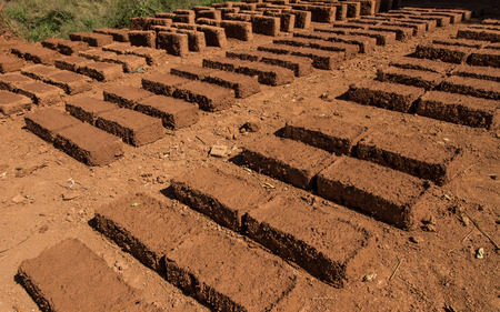earthen: Dry earthen brick in the sun. Stock Photo
