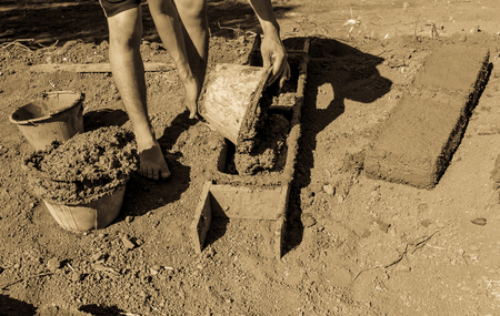 chaff: How to make earthen  brick. Stock Photo