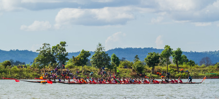 dragonboat: SAVANNAKHET,LAOS-NOVEMBER 13 : Long boat racing in Setamuak river at Savannakhet,Laos on November 13 ,2015.Long boat racing is the popular culture in Laos .