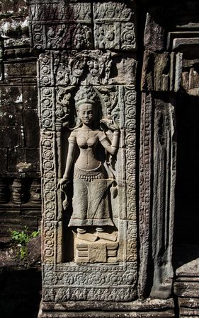 apsara: Apsara dancing stone carving at the bas-relief of Banteay Kdei . Stock Photo