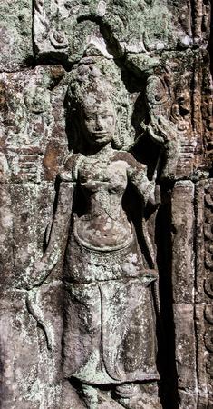 apsara: Bas-relief of apsara dancing in Banteay Kdei. Stock Photo