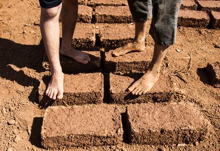 earthen: Standing on dried earthen brick. Stock Photo