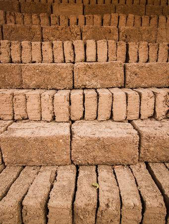 chaff: Earthern bricks close up background. Stock Photo