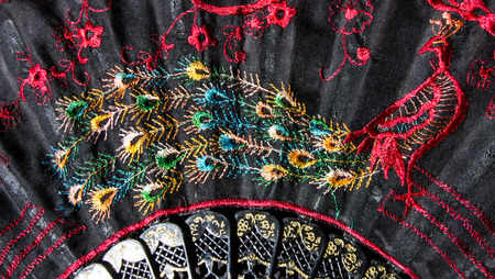 lappet: Embroider peacock on hand fan.