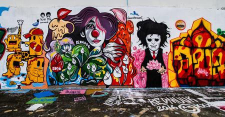 window graffiti: UBON RACHATANEE,THAILAND -JULY 19: Graffiti on the market wall beside Moon river on July 19,2016.Artist can show their art around this market wall. Editorial