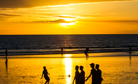 kuta: View of sunset at Kuta beach .