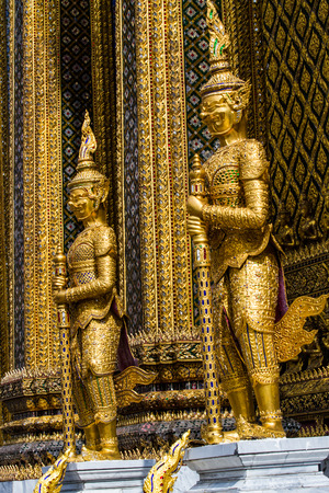 giants: Thai style giant statues in Emerald buddha temple. Stock Photo