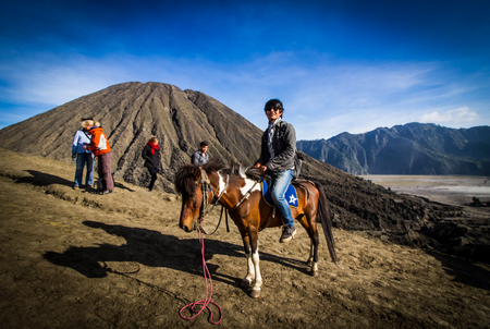 EAST JAVA, INDONESIA - AUGUST 25: Tourist riding the horse to Mount Bromo volcano on August 25,2016 in East Java, Indonesia.