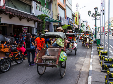 YOGYAKARTA, INDONESIA - AUGUST 27: View of pedicab trishaw tricycle on August 27,2016 in Yogyakarta, Indonesia.This service available for tourist around the city.