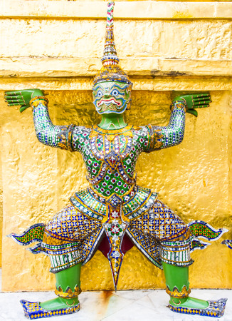 Thai style giant statue in Emerald buddha temple. Stock Photo