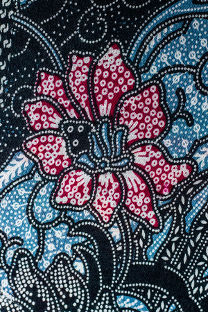 Abstract flower print fabric close up background.
