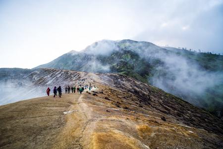 sulphuric acid: BANYUWANGI,INDONESIA-AUGUST 24 : Turist and labor on the way to  Kawah Ijen lake in Banyuwangi, Indonesia on August 24,2016.