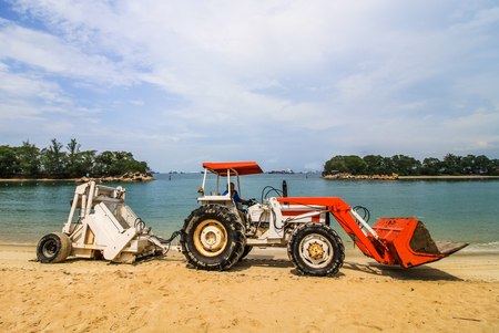 SINGAPORE - AUGUST 30,2016: Truck cleaning and leveling beach at Sentosa island in Singapore on August 30,2016.Sentosa island  have many beach . Editorial