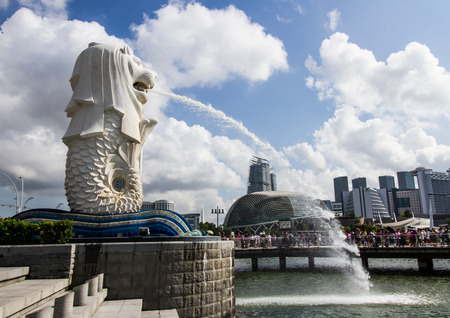 stone lion: SINGAPORE-AUGUST 31: The Merlion beside Marina bay in Singapore view on August 31,2016. Merlion is a imaginary creature with the head of a lion,seen as a symbol of Singapore S