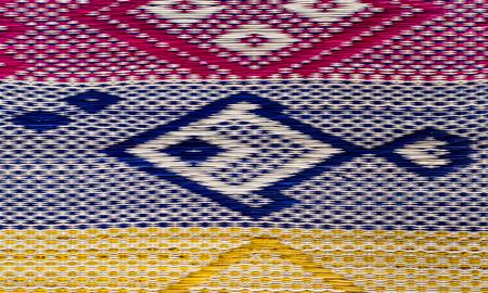 trabajo manual: Fish pattern of  papyrus mat close up background . Foto de archivo
