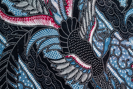 Abstract bird print fabric close up background. Stock Photo