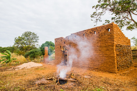 adobe wall: Earthen house with smoked foreground.
