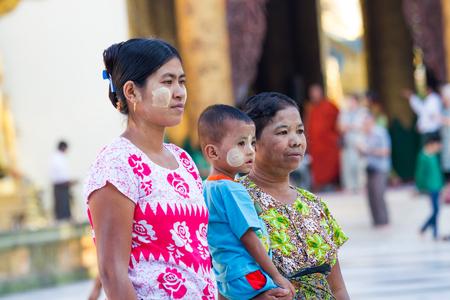 YANGON,MYANMAR-MARCH 15,2017:  Burmese family  put thanaka on their face visiting shwedagon pagoda in Yangon,Myanmar.