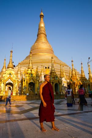 YANGON,MYANMAR-MARCH 15,2017: The monk  walking  around Shwedagon pagoda in Yangon ,Myanmar.Swhedagon pagoda is the most famous pagoda in Myanmar.
