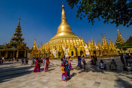 YANGON,MYANMAR-MARCH 15,2017: Famous Shwedagon Pagoda (Stupa) with visitors, tourists and locals walking around .The golden pagoda in  Yangon , Myanmar.