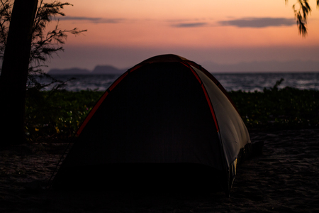 Traveller tent on the beach in the morning. Stock Photo