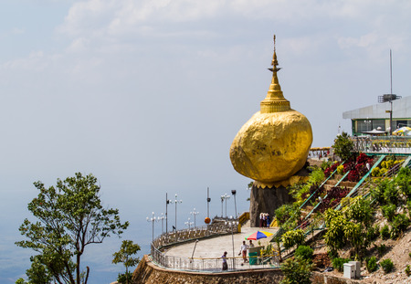 KYAIKTIYO,MYANMAR-MARCH 13,2017: Pilgrims are praying at the Kyaiktiyo Pagoda, Golden Rock. Kyaiktiyo Pagoda also known as Golden Rock is a well known Buddhist pilgrimage site in the Mon State, Myanmar.