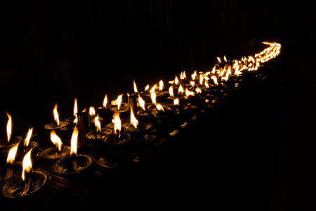 Candles light line in the dark.