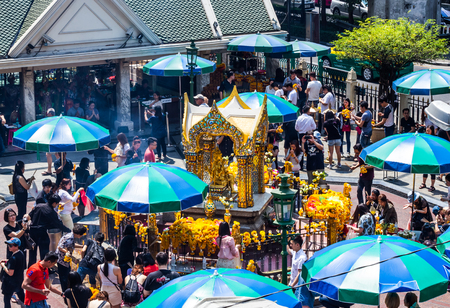pilgrim journey: BANGKOK,THAILAND-FEBRUARY 21,2017: View of Erawan Shrine. People come to worship and pay respect to the Erawan Shrine located at Grand Hyatt Erawan Hotel (Ratchaprasong Junction). It is one of the most popular tourist destinations .