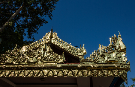 building feature: Burmese art detail in the temple.