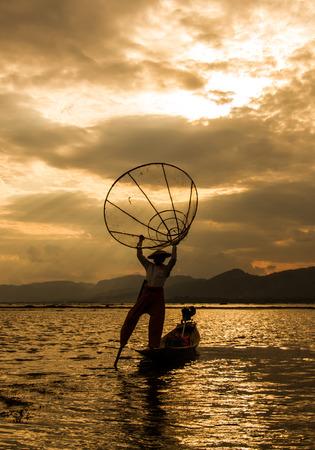 net: Fishermen in Inle Lake at sunrise, Shan State, Myanmar
