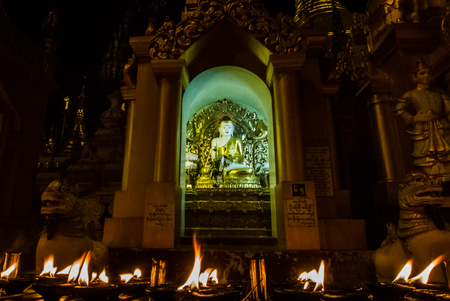 antiquity: Candles light in front of buddha image. Stock Photo