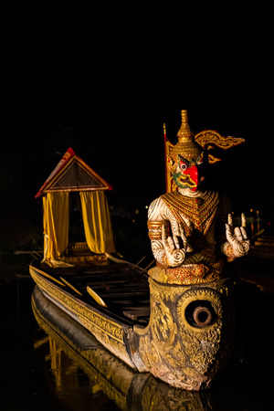 Thai boat with garuda  decoration in the buddhist temple.