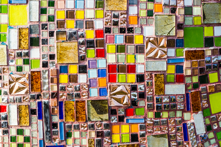 lit image: Colorful mosaic wall close up background. Stock Photo