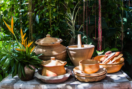 Various earthenware in the garden. Stock Photo