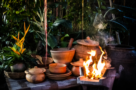 Flame in the stove with earthenware in the garden.