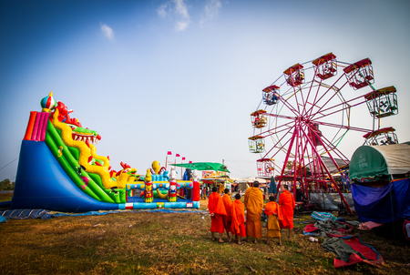 SAVANNAKHET,LAOS-OCTOBER 29,2017 : Giant playground and ferris wheel in Longtail boat racing festival in Savannakhet,Laos .This festival will be after end of Buddhist lent every year.