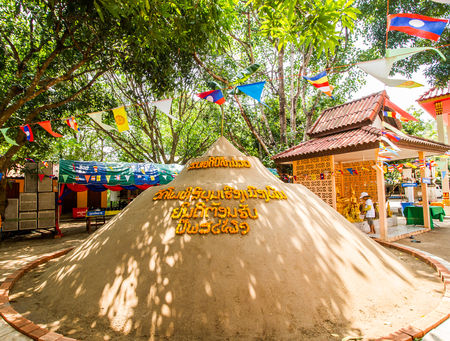 SAVANNAKHET,LAOS-APRIL 16,2018 : Buddhist building sand castle in the temple to celebrate  Songkran festival in Savannakhet,Laos on April 16,2018.Songkran festival is Laos new year. Editorial