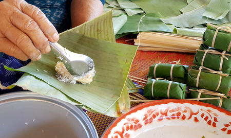Thai sweet cooking wraped by banana leaf.
