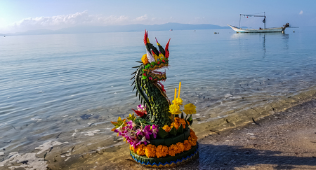 """Thai style flower decoration'Kratong naga""""floating to the sea."""