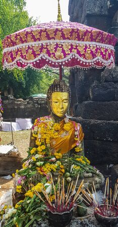 Golden face buddha in ancient temple .