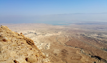 judaean: Masada is an ancient fortification in the Southern District of Israel situated on top of an isolated rock plateau, akin to a mesa. It is located on the eastern edge of the Judaean Desert, overlooking the Dead Sea 20 km east of Arad. Editorial