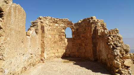 Masada is an ancient fortification in the Southern District of Israel situated on top of an isolated rock plateau, akin to a mesa. It is located on the eastern edge of the Judaean Desert, overlooking the Dead Sea 20 km (12 mi) east of Arad. Stock Photo
