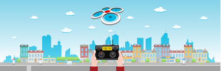 controlled: Drone quadrocopter flies above a long city street controlled remotely from the ground