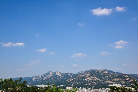 city park skyline: CIty skyline in the lunch (Bukhansan National Park) SEOUL, KOREA - June 14,2016