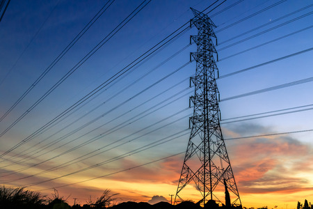 stell: Line of electrical towers and power lines at sunset  Horizontal shot  Stock Photo