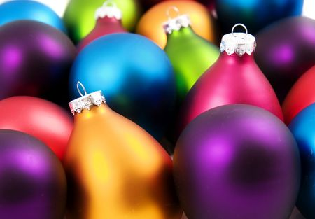 A bunch of very brightly colored christmas ornaments photo