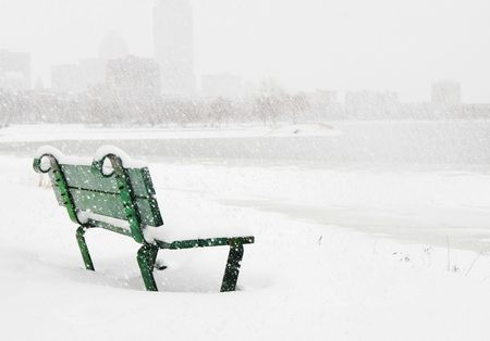Bench in the snow on Charles River in Boston